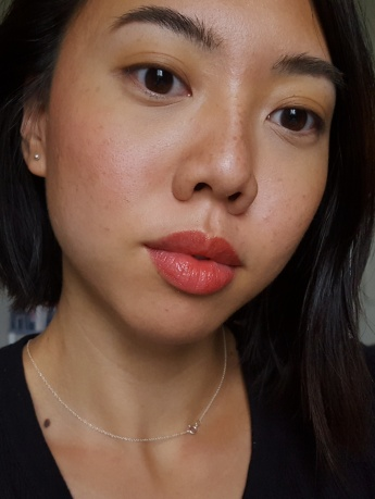 Chanel Rouge Coco Lip Blush in 412 Orange Explosive on lips and cheeks